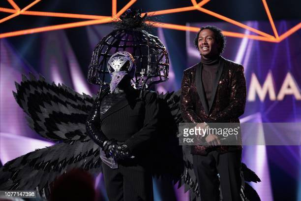 Raven and host Nick Cannon in the New Masks on the Block episode of THE MASKED SINGER airing Wednesday Jan 9 on FOX