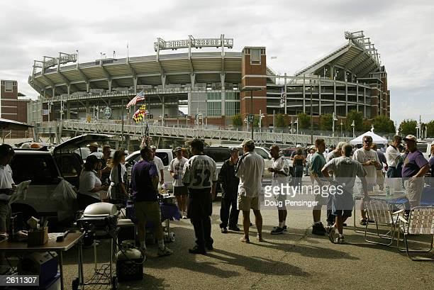 Raven fans tailgate in front of M&T Bank Stadium before the game between the Baltimore Ravens and the Kansas City Chiefs on September 28, 2003 at the...