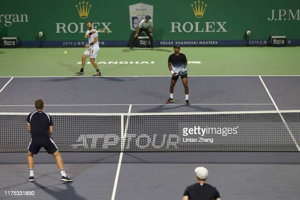 Raven Klaasen of Russia and Michael Venus of New Zealand reacts during the 2019 Rolex Shanghai Masters Men's doubles quarterfinal match against Jamie...