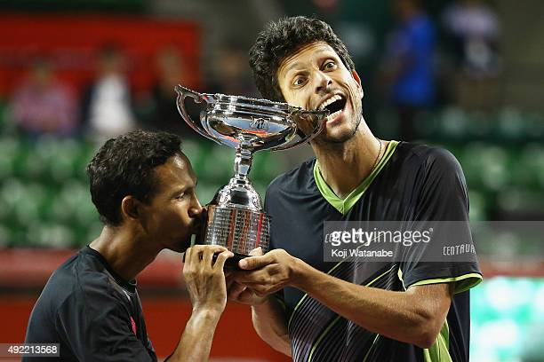 Raven Klaasen of South Africa and Marcelo Melo of Brazil celebrate with the trophy after winning the men's doubles final match against Juan Sebastian...