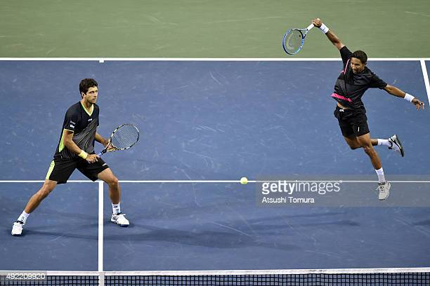 Raven Klaasen of South Africa and Marcelo Melo of Brazil compete against Juan Sebastian Cabal of Colombia and Robert Farah of Colombia during the...