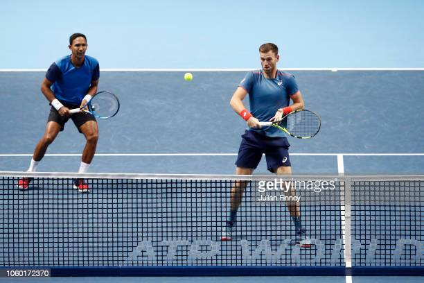 Raven Klaasen of South Africa and Michael Venus of New Zealand in action during their match against Jamie Murray of Great Britain and Bruno Soares of...