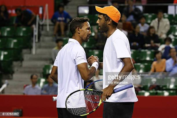 Raven Klaasen of South Africa and Rajeec Ram of United States celebrate after winning the men's doubles semifinal match against AisamUlHaq Qureshi of...