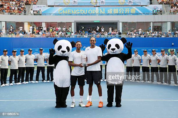 Raven Klaasen of South Africa and Rajeev Ram of the United States pose with their trophy after their doubles final match against Pablo Carreno Busta...