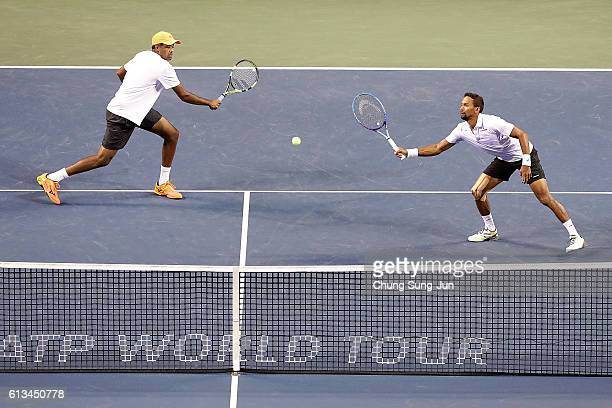 Raven Klaasen of South Africa and Rajeev Ram of United States in action during the men's doubles final match against Marcel Granollers of Spain and...