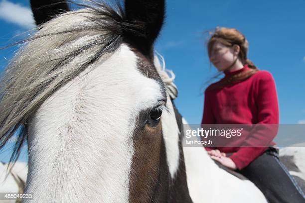 Raven Owen daughter of the Yorkshire Shepherdess Amanda Owen rides one of their horses as her and her mother head onto the moors to feed them on...