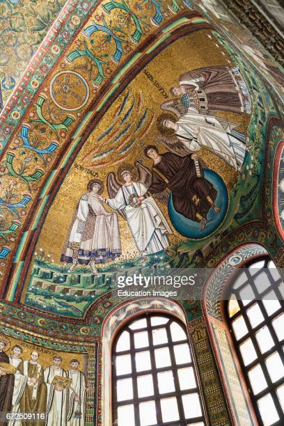 Ravenna Ravenna Province Italy Mosaic in apse of San Vitale of Christ flanked by two angels and St Vitalis and Bishop Ecclesius Christ is handing the...