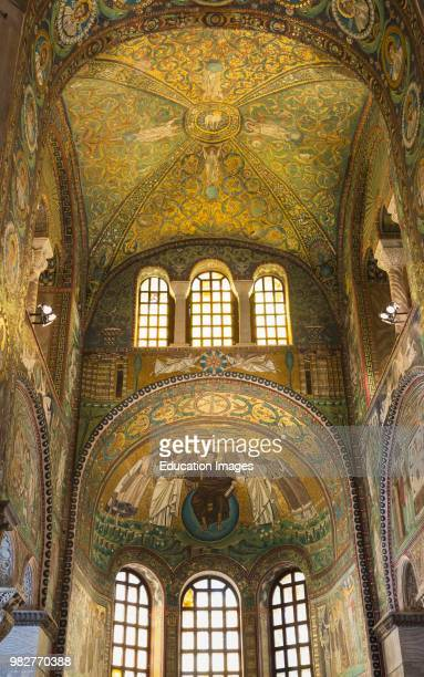 Ravenna Ravenna Province Italy Mosaic in San Vitale basilica Christ seated on an orb representing the world offers the crown of martyrdom to St...