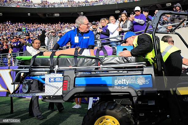 Ravens cheerleader is taken off the field after falling while performing during a game between the Baltimore Ravens and Tennessee Titans at MT Bank...