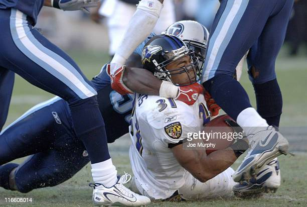 Ravens running back Jamal Lewis is tackled by Titan Chris Hopeat LP Field Nashville Tennessee November 12 2006 The Ravens came from behind to defeat...