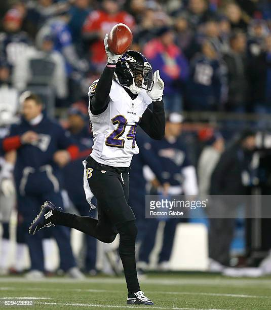 Ravens' Shareece Wright reacts after recovering a fumble by Patriots' Matthew Slater in the third quarter. New England Patriots play against the...