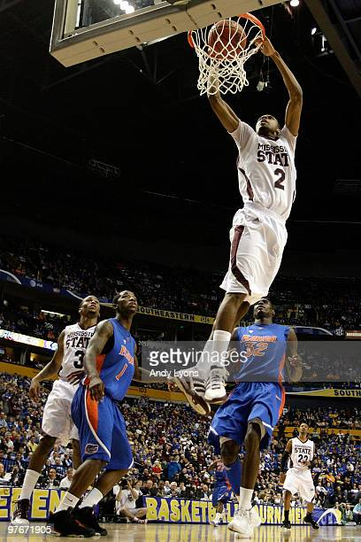 Ravern Johnson of the Mississippi State Bulldogs dunks against the Florida Gators during the quarterfinals of the SEC Men's Basketball Tournament at...