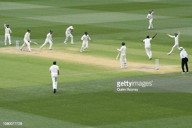 Ravi Ashwin of India celebrate getting the wicket of Josh Hazlewood of Australia and winning the test match during day five of the First Test match...