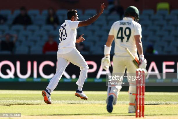 Ravi Ashwin of India celebrates taking the wicket of Steve Smith of Australia during day two of the First Test match between Australia and India at...