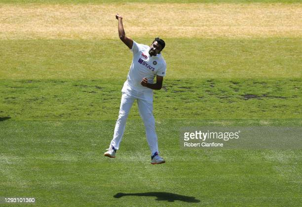 Ravi Ashwin of India celebrates taking the wicket of Steve Smith of Australia during day one of the Second Test match between Australia and India at...