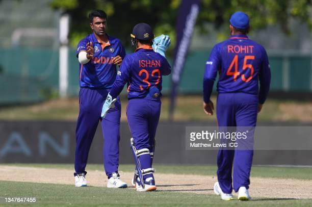 Ravi Ashwin of India celebrates the wicket of David Warner of Australia with team mate Ishan Kishan during the India and Australia warm Up Match...