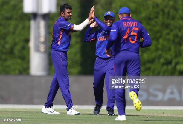 Ravi Ashwin of India celebrates the wicket of Mitchell Marsh of Australia during the India and Australia warm Up Match prior to the ICC Men's T20...