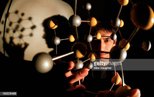 Ravi Bhat holds a model of a Gallium Arsenide molecule that show it's crystal structureRavi is working on his PHD at U of T and along with his...