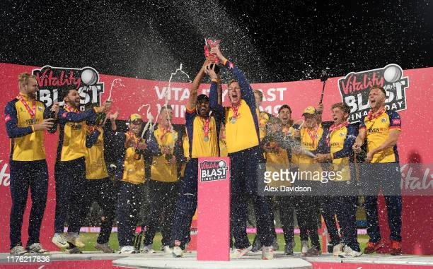 Ravi Bopara and Simon Harmer lift the Vitality Blast Trophy with their Essex teammates during the Vitality T20 Blast Final match between...