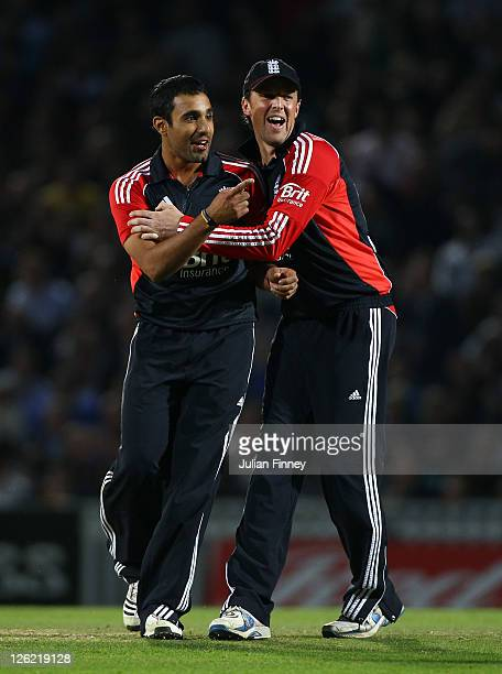 Ravi Bopara is congratulated by Graeme Swann of England after taking the wicket of Christopher Barnwell of West Indies during the NatWest...