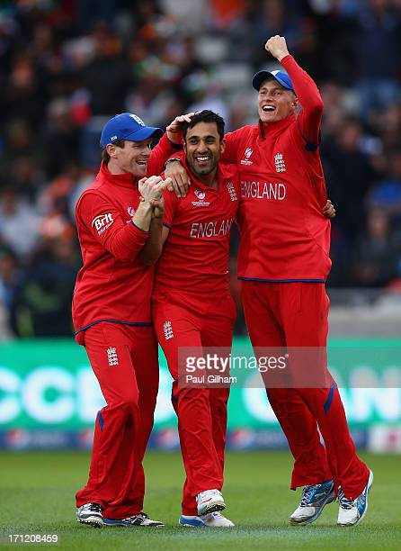 Ravi Bopara of England celebrates with Eoin Morgan and Joe Root after taking the wicket of MS Dhoni of India for no runs after he was caught out by...