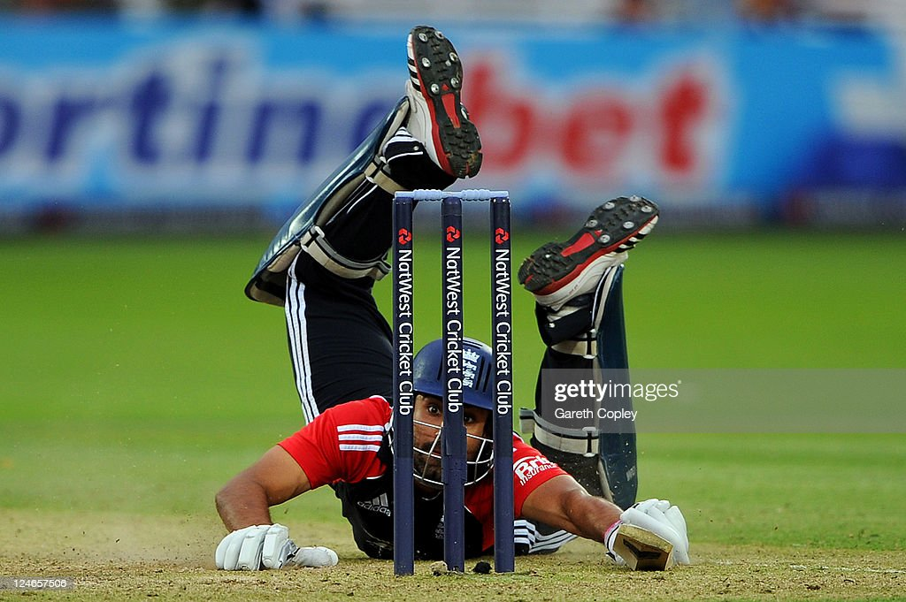 Ravi Bopara of England dives into his crease after being sent back by batting partner Graeme Swann during the 4th Natwest One Day International match between England and India at Lord's Cricket Ground on September 11, 2011 in London, United Kingdom.