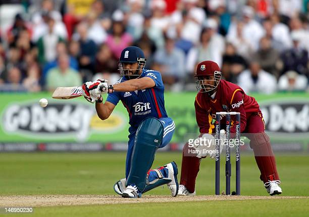 Ravi Bopara of England hits out watched by the West Indies wicketkeeper Denesh Ramdin during the NatWest International T20 match between England and...
