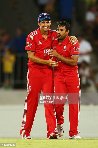Ravi Bopara of England is congratulated by Alastair Cook after taking a wicket during the International tour match between the Prime Minister's XI...
