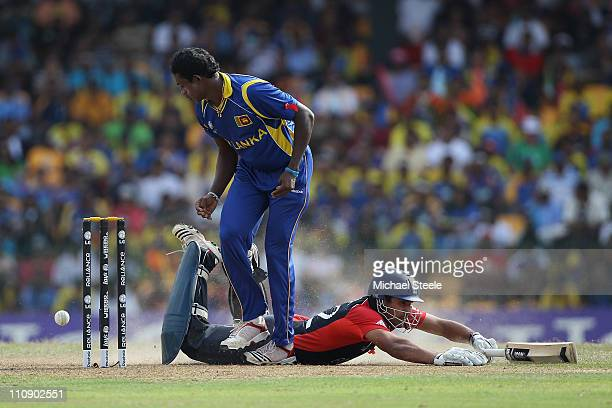 Ravi Bopara of England makes his ground as Ajantha Mendis watches the ball during the 2011 ICC World Cup QuarterFinal match between Sri Lanka and...