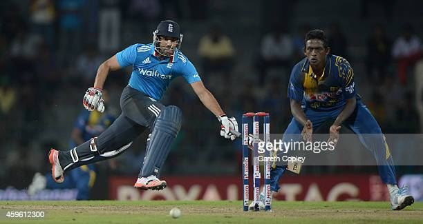 Ravi Bopara of England makes his ground underpressure from Ajantha Mendis of Sri Lanka during the 1st One Day International between Sri Lanka and...