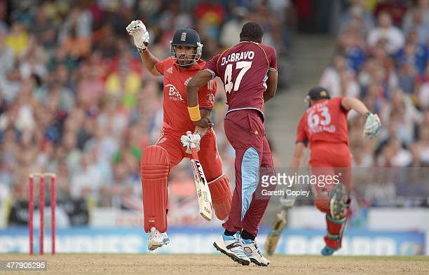 Ravi Bopara of England runs into Dwayne Bravo of the West Indies during the 2nd T20 International match between the West Indies and England at...