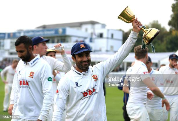 Ravi Bopara of Essex lifts the County Championship trophy during day three of the Specsavers County Championship Division One match between Essex and...