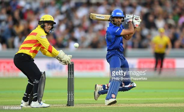 Ravi Bopara of London Spirit hits out watched by Tom Moores of Trent Rockets during The Hundred match between London Spirit and Trent Rockets at...