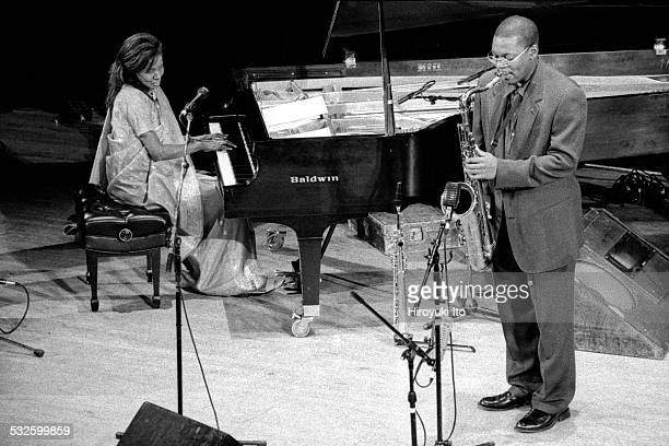 Ravi Coltrane and Alice Coltrane performing at Town Hall as part of the Texaco New York Jazz Festival on June 14 1998This imageAlice Coltrane left...