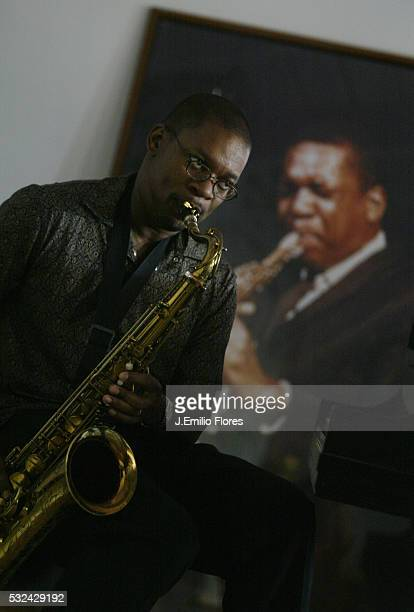 Ravi Coltrane in front of a photograph of his father john Coltrane at his mother Alice's home