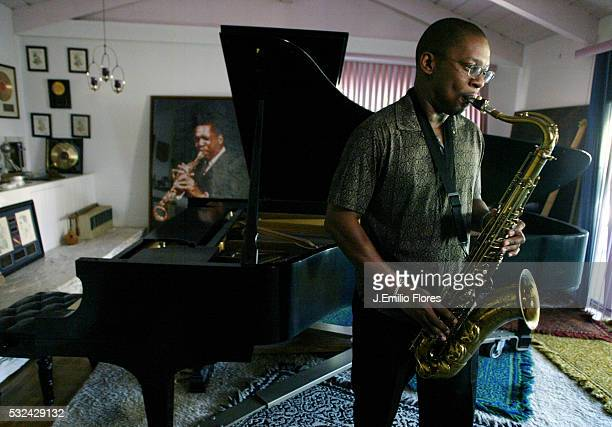 Ravi Coltrane plays the saxophone at his mother Alice Coltrane's home He stands in front of a photograph of his father John Coltrane and a Steinway...