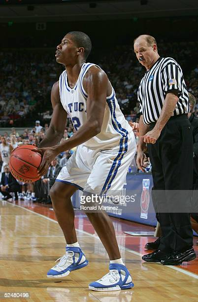 Ravi Moss of the Kentucky Wildcats sets up for a three point shot during the 2005 NCAA division 1 men's basketball championship tournament game...