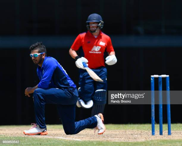 Ravi Patel of South watches the ball as Steven Mullaney of North runs during the ECB North v South Series match Two at Kensington Oval on March 21...