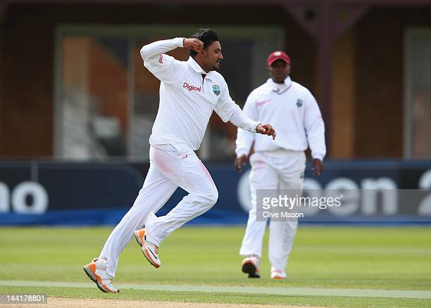 Ravi Rampaul of West Indies celebrates dismissing Ian Bell of England Lions during day two of the tour match between England Lions and West Indies at...