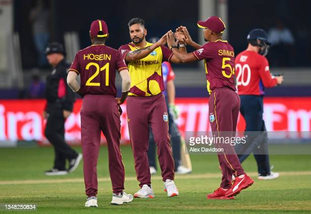 Ravi Rampaul of West Indies celebrates the wicket of Jason Roy of England during the ICC Men's T20 World Cup match between England and Windies at...