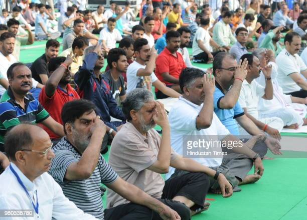 Ravi Shankar Prasad Sushil Kumar Modi along with other participants perform yoga on the occasion of the 4th International Yoga Day on June 21 2018 in...