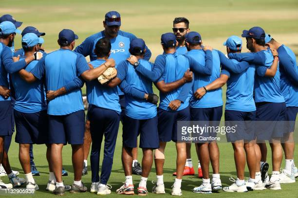 Ravi Shastri coach of India and Virat Kohli of India speak to the team ahead of game one of the One Day International series between India and...