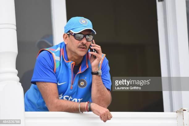 Ravi Shastri of India speaks on the phone during net practice at Trent Bridge on August 29 2014 in Nottingham England