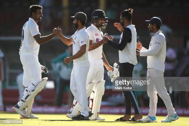Ravichandran Ashwin, Ajinkya Rahane, Hanuma Vihari and Mohammed Siraj of India celebrate securing a draw during day five of the Third Test match in...