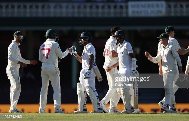 Ravichandran Ashwin and Hanuma Vihari of India are acknowledged by the Australian players after the match ended in a draw during day five of the 3rd...