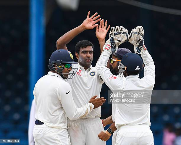 Ravichandran Ashwin and Rohit Sharma of India celebrate the dismissal of Darren Bravo of West Indies during day 1 of the 4th and final Test between...