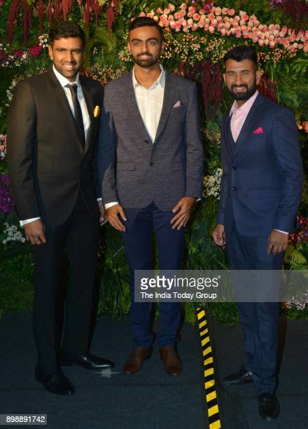 Ravichandran Ashwin Cheteshwar Pujara and Jaydev Unadkat at Virat Kohli and Anushka Sharmas reception in Mumbai