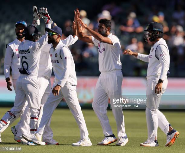 Ravichandran Ashwin of India celebrates after dismissing Steve Smith of Australia during day two of the First Test match between Australia and India...