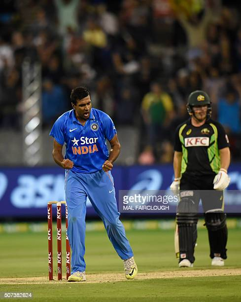 Ravichandran Ashwin of India celebrates after taking the wicket of Shaun Marsh of Australia during the second Twenty20 international cricket match...