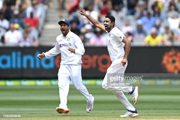 Ravichandran Ashwin of India celebrates getting the wicket of Marnus Labuschagne of Australia during day three of the Second Test match between...
